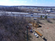 Overview- note the Drill Rig behind the eastbound tractor-trailer